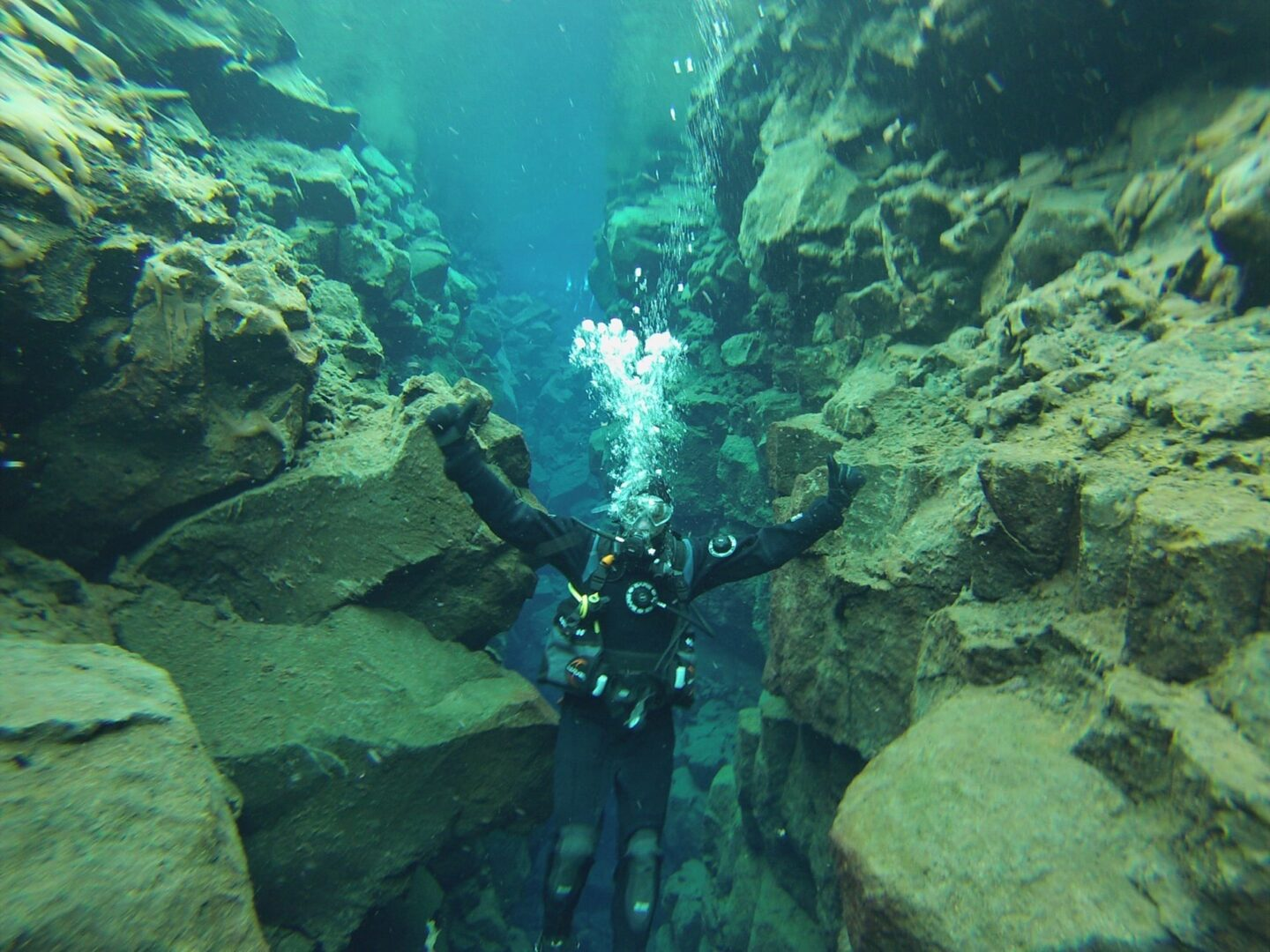 Touching the tectonic plates of America and Europe, Iceland